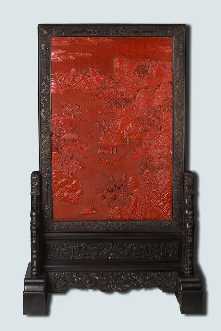 A LARGE CINNABAR LACQUER LANDSCAPE TABLE SCREEN