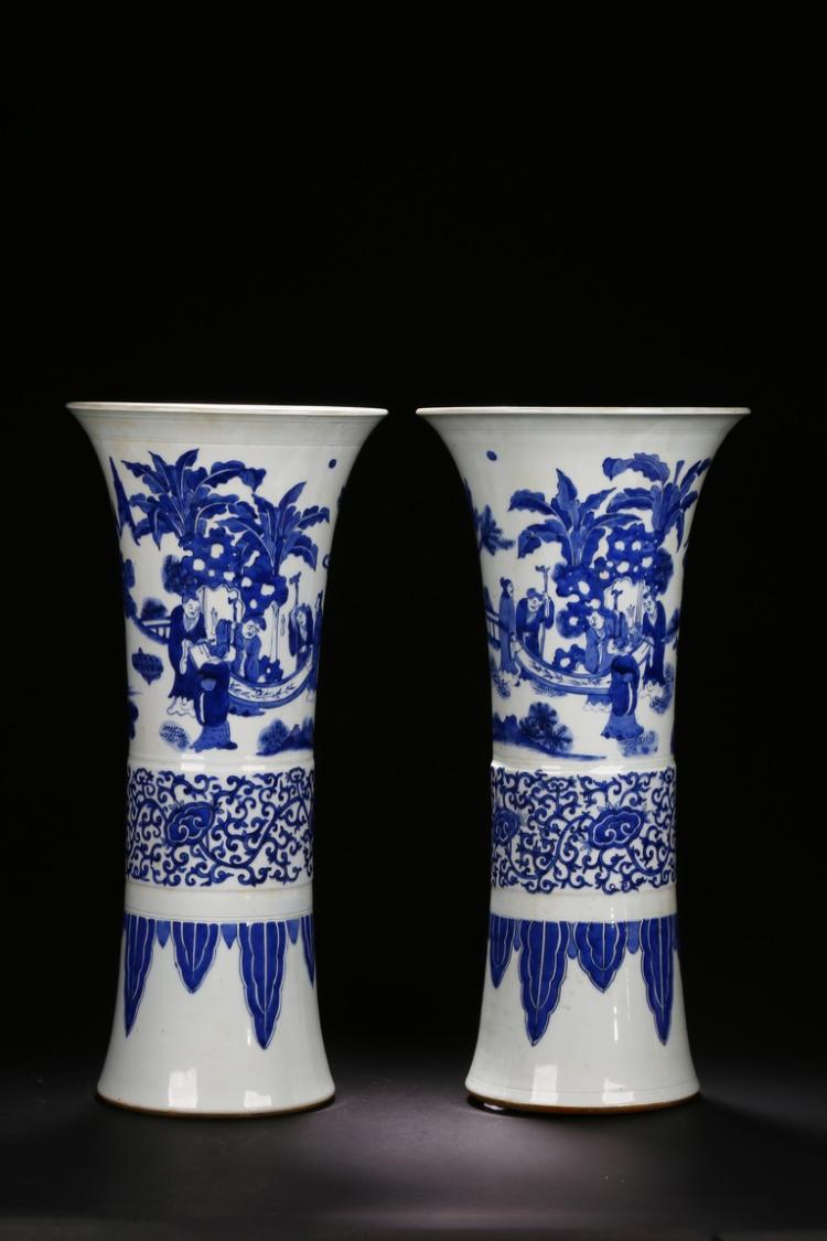 A PAIR OF WHITE AND BLUE 'FIGURE' BEAKER VASE