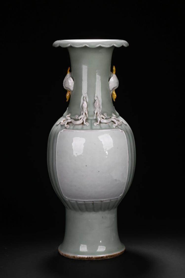 A CELADON AND WHITE GLAZE VASE