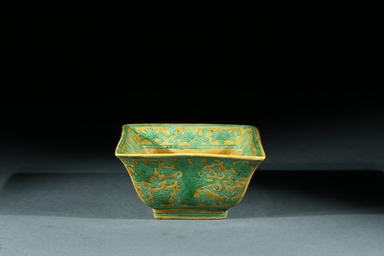A YELLOW GROUND GREEN ENAMEL 'PHOENIX' SQUARE BOWL
