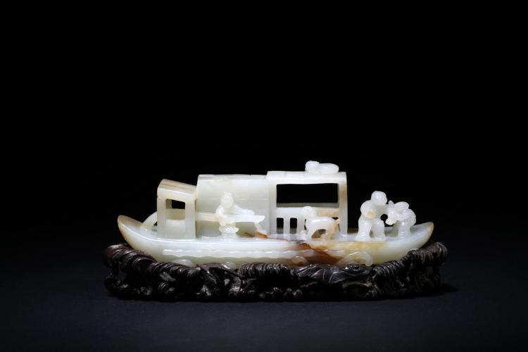 A WELL-CARVED WHITE JADE SAMPAN
