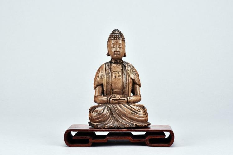 A STONE CARVED FIGURE OF BUDDHA