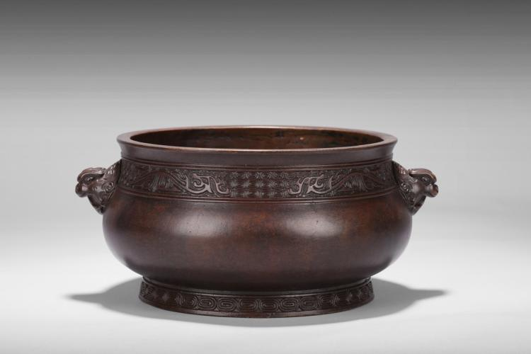 A LARGE BRONZE CENSER WITH TWO BEAST HANDLES