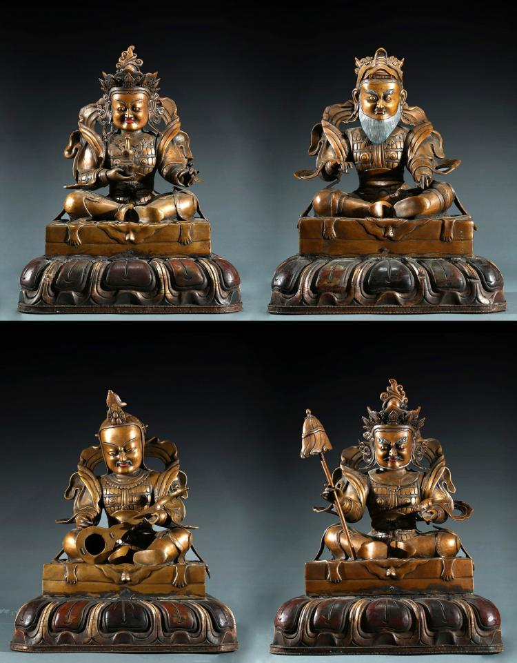 A SET OF FOUR BRONZE GUARDIAN KINGS