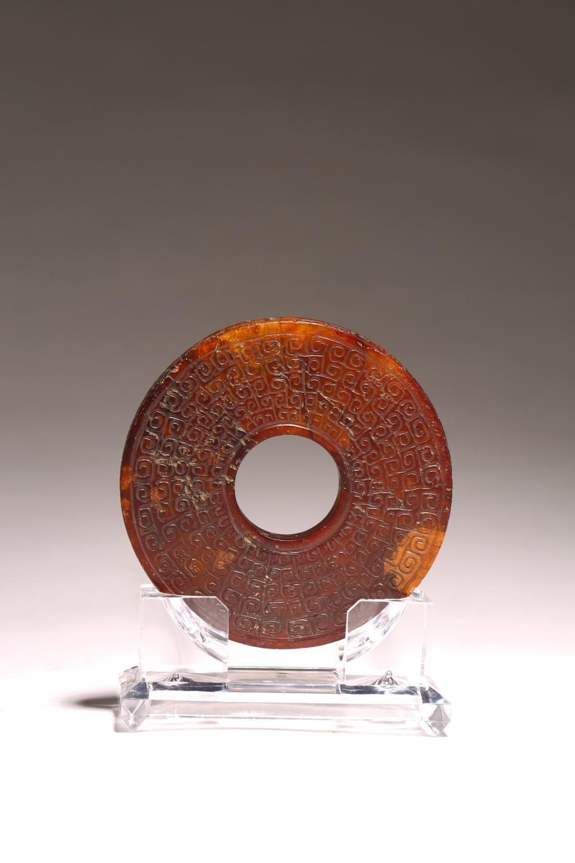 A CHINESE RUSSET BROWN JADE DISC BI