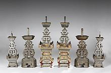 A GROUP OF SIX CANDLE HOLDERS IN THREE PAIRS