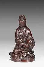 A CARVED WOOD FIGURE OF GUANYIN