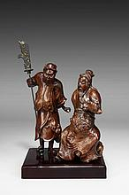 A CARVED BOXWOOD ROOT 'GUANGONG AND ZHOUCANG' FIGURAL GROUP