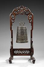 A BRONZE BELL AND WOOD STAND
