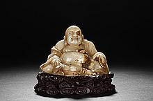 A CARVED SHOUSHAN STONE MAITREYA BUDDHA FIGURE