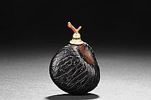 A ZITAN WOOD ROOT CARVED SNUFF BOTTLE