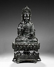 A MAGNIFICENT BRONZE FIGURE OF GUANYIN ON LOTUS STAND