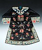 A CHINESE DECORATED BLACK ROBE