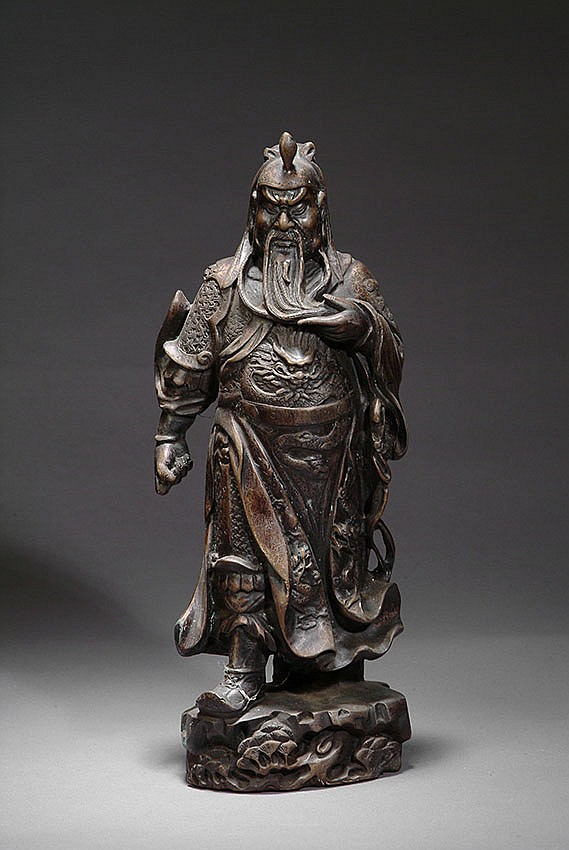 A BRONZE FIGURE OF GUANYU