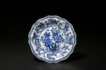 A BLUE AND WHITE 'FLOWERS AND BUTTERFLY' DISH