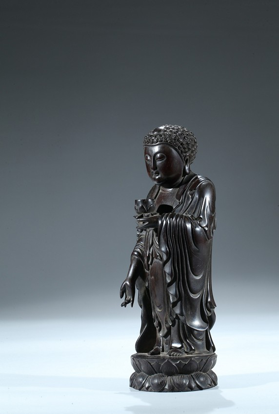 A Zitan Carved Figure Of Standing Shakyamuni