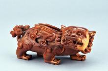 A BONE CARVED BUDDHIST LION