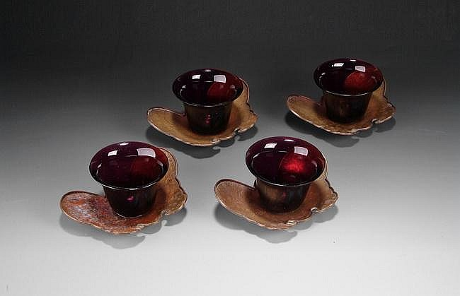 A SET OF FOUR PEKING GLASS CUPS WITH SILVER CUP STANDS