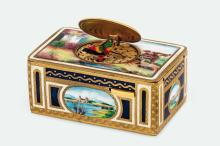 A fine and very rare magnificent vintage enamelled and gilt singing box with key. Made circa 1900