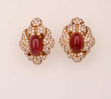 Pair of ruby and diamond earrings. Signed Bulgari. Fitted case
