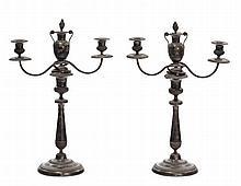 Coppia di candelieri in argento a tre luci, nord Italia XIX secolo