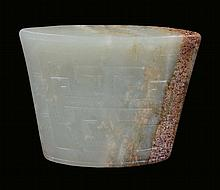 A Celadon and russet jade, archaic shape, China,