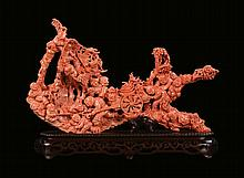A carved coral with figures and cart, China, early