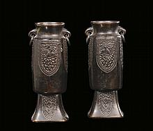 A pair of bronze cylindrical carved vases, China,