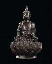 A bronze Buddha on lotus flower, China, Ming
