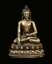 A rare and important bronze Amitaya with silver