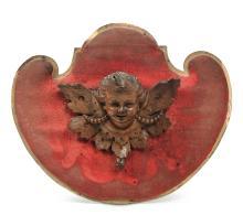 Testina di putto alato in legno scolpito, XVIII-XIX secolo,