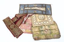 Quattro centrini in damasco e tessuto ricamato in fili d'argento e seta, Italia XIX secolo,