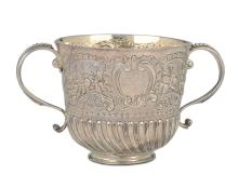A molten, embossed and chiselled silver Porringer, silversmith Edward Wimans, London 1698