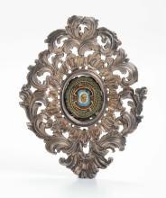 Cornice in argento a motivi vegetali con reliquia centrale, XIX secolo,