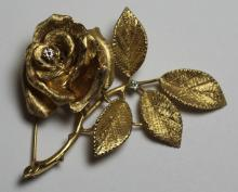 JEWELRY. 14kt Gold and Diamond Rose Form Brooch.