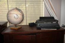 Brother electronic typewriter and world globe on wooden mount