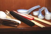 Brass and bone servers, chopsticks and holders