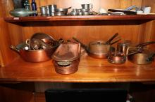 Copper jelly moulds, copper saucepans, fry pans, bowls and fish cooker