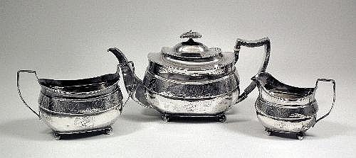 A George III silver three piece tea service with