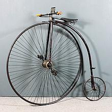 A Victorian black japanned metal ordinary bicycle or