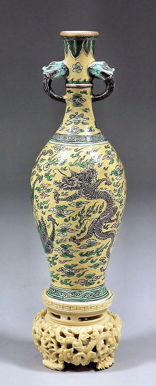 A Chinese porcelain bulbous miniature two-handled