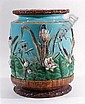 19th Century maiolica garden seat, probably by George Jones, the cylindrical body moulded in bold relief and decorated in colours withbirds, dragonflies, bulrushes and water lilies, on a turquoise ground the top and footrim moulded in relief with
