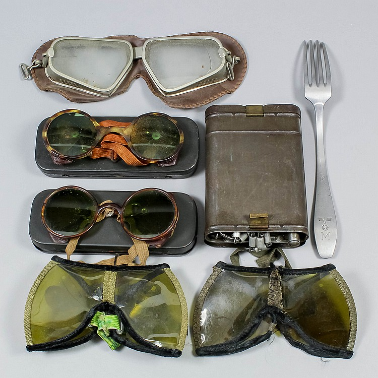 Two pairs of German World War II desert sand goggles, a pair