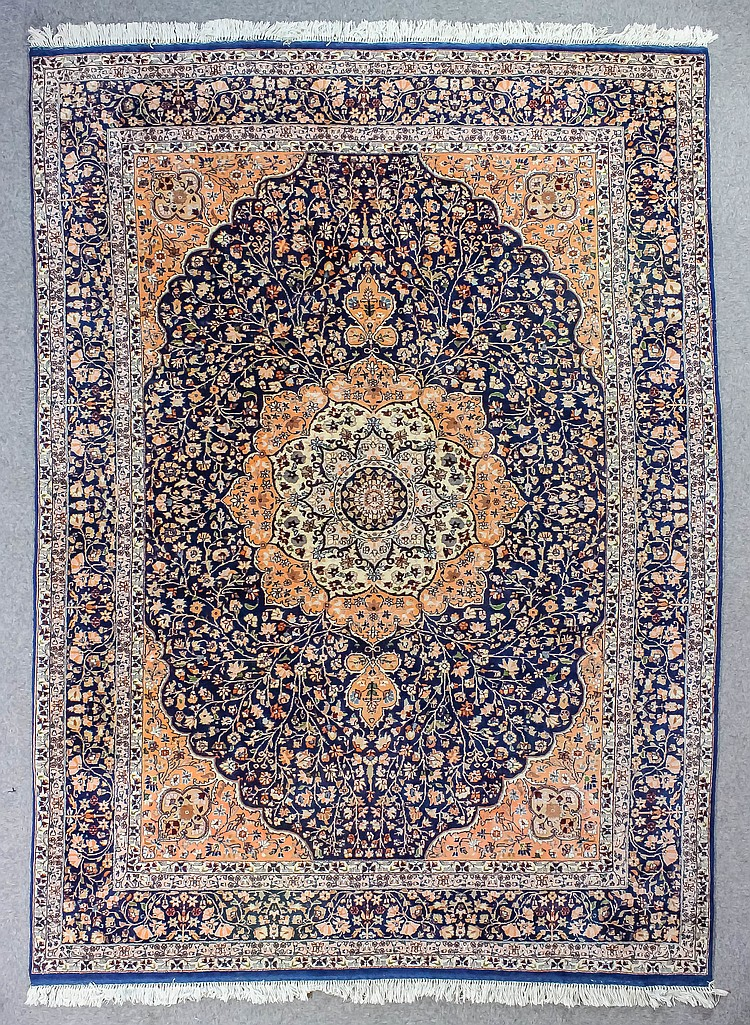 An Eastern Carpet Of Kirman Design Woven In Pastel Colours W