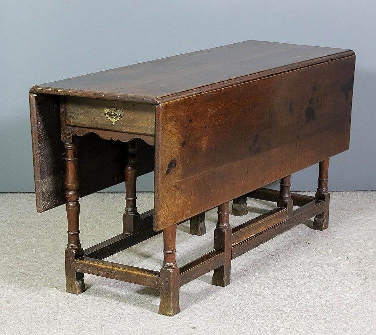An old oak rectangular gateleg table with dummy drawer to fr - Gateleg table with drawers ...