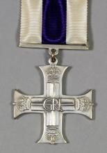A George VI Military Cross (unnamed), in Royal Mint mauve leather covered case of issue and an Elizabeth II British Empire Medal (unnamed - military issue),in Royal Mint red leather covered case of issue