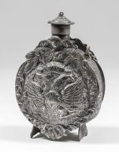 A plated brass imperial Russian powder flask cast with the double headed eagle to both faces and to the sides and with original chained cover, 5ins high
