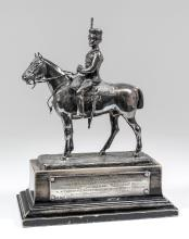 An early 20th Century plated equestrian presentation model of a mounted hussar on ebonised stepped base, with silver engraved plaque -