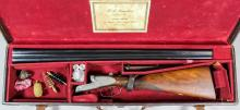 A 12 bore sidelock ejector shotgun by J.J Langley of Luton, Serial No.1800, the 28ins blued steel barrels with plain top rib, bright steel action with scroll engraving, walnut stock and fore end with composite butt plate, 45ins overall, in motor case with some accessories <br>Note: You must be in possession of a current shotgun certificate in order to purchase this item.