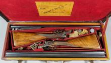 A composed pair of 12 bore sideplated box lock ejector shotguns by Cogswell & Harrison, serial No's. 41117 & 29475, the 30ins blued steel barrels with plain ribs, cased hardened actions with scroll engraving, walnut stocks and fore ends, 47ins overall, in manufacturers pair motor case with some accessories <br>Note: You must be in possession of a current shotgun certificate in order to purchase this item.